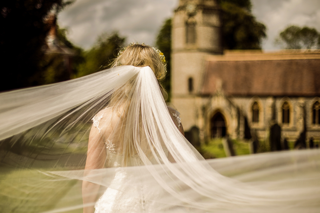 wedding dress photo taken at Welford Church, Newbury