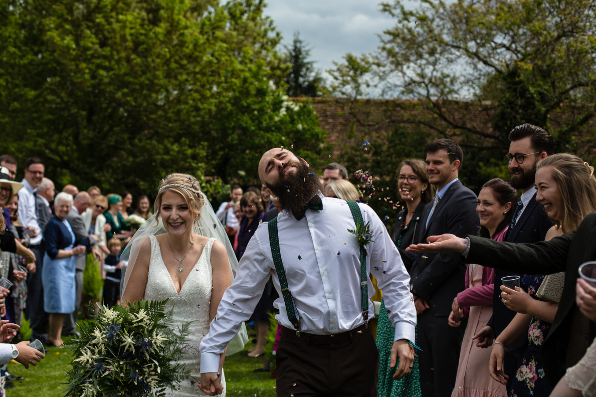 Throwing the confetti photograph at  a wedding in Berkshire